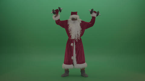Man santa costume lifts dumbells over green screen background Footage