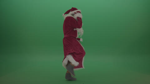 Man in santa costume display some amazing dance moves over chroma key background Live Action