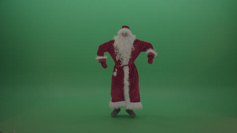 Happy santa dances to the tune over chromakey background Live Action