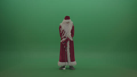 Funny santa scores 10 points playing golf over green screen background Footage