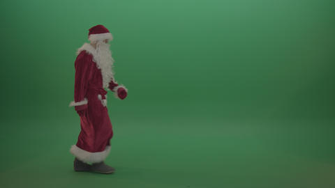 Funny man in santa clause costume walking across the green screen background Footage