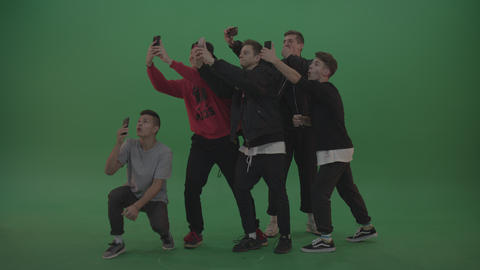 Break dance team take group selfies over chromakey background Footage