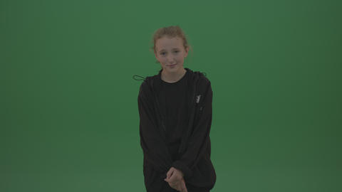 Shy girl in black wear poses over chromakey background ライブ動画
