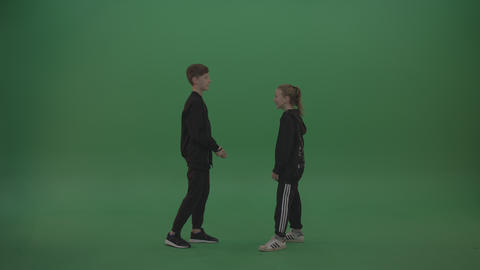 Two kids smile and stare at each other over chromakey… Stock Video Footage