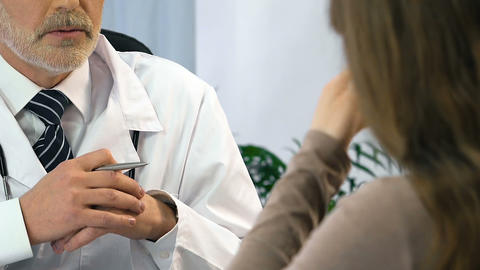 Experienced oncologist talking with woman about incurable disease, bad news Live Action