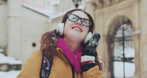 Closeup portrait of cute smiling young girl being exited about the snowy weather Footage