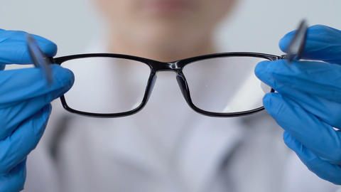 Optometrist offering eyeglasses patient, eyesight checkup, doctor prescription Live Action