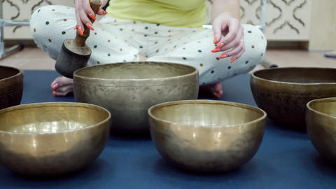 Woman with tibetan singing bowl Footage