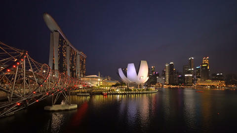Downtown Singapore city in Marina Bay area at night. Financial district and Live Action