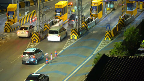 Toll road payment checkpoint on motorway with gates at night. Pay road in Footage