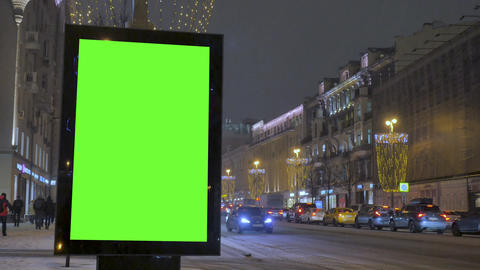 A big billboard with a green screen on the street decorated for the holiday Footage