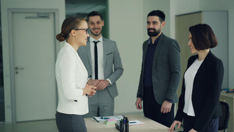 Company CEO is congratulating a successful candidate after job interview Live Action