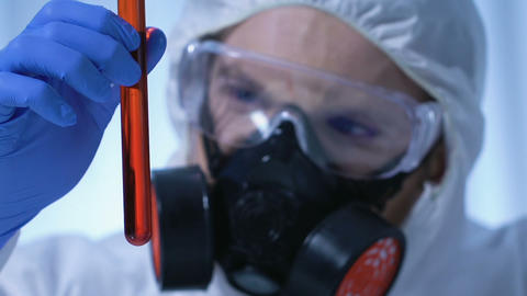 Expert examining flask with toxicological substance, disease control center Footage