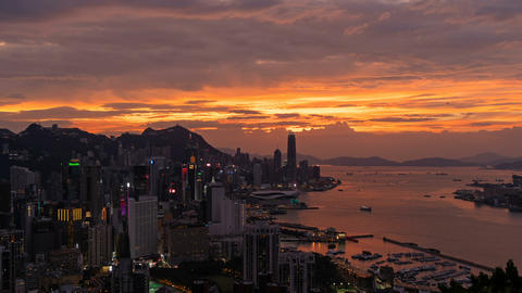 Hong Kong Downtown Time lapse day to night. Victoria Harbour. Financial district Live Action