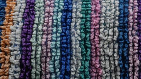 Colorful horizontal stripes closeup texture of a beach towel Footage
