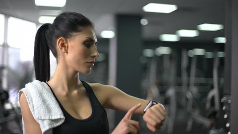 Fit woman checking workout results at smart watch hologram, sport innovation Footage