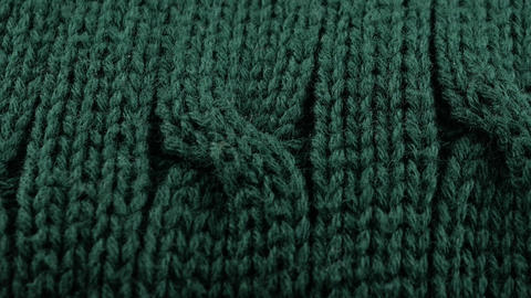 Pigtails on Green Knitwear Fabric Texture. Machine Knitting Texture Macro Footage