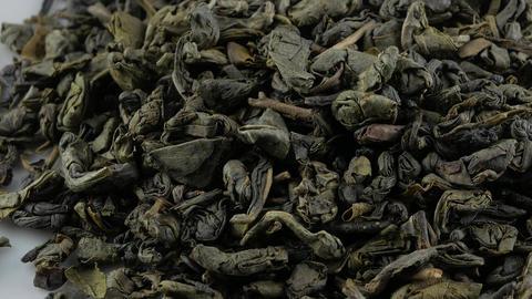 Tea herbs texture. Green tea. Organic dried green tea leaves Live Action