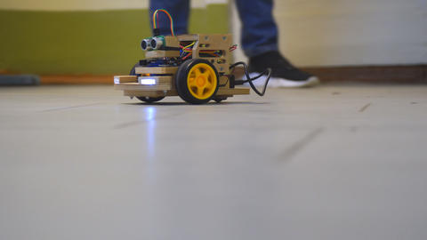 Homemade model cars rides on the floor. Designs the model of the machine or car Live Action