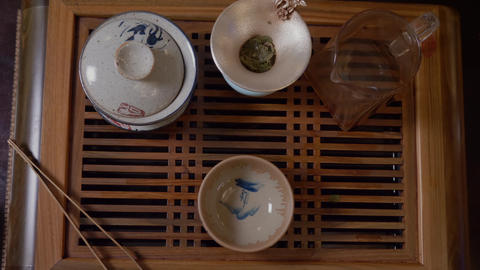 Master pouring tea infusion from fairness cup to tea bowl. Chinese tea ceremony Live Action