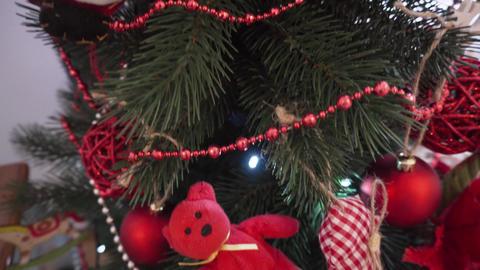 Beautiful decorated christmas tree. Toy bear, santa, balls and garlands Footage