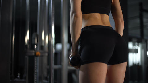 Closeup of sportive female butts and sweaty back, woman tough workout in gym Live Action