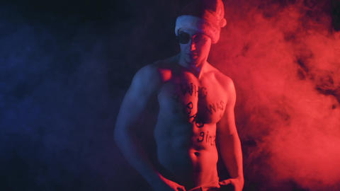 Cool Santa in color smoky background Footage