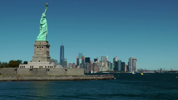 USA New York City 399 passing statue of liberty in front dreamlike skyline Footage