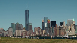 USA New York City 404 Lower Manhattan skyline seen from Liberty Island riverside Footage