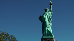USA New York City 416 statue of liberty with blue sky and moon in background Footage