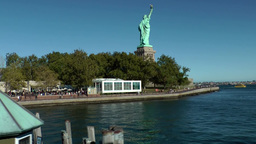 USA New York City 419 Liberty Island; departure of statue cruises ferryboat Footage