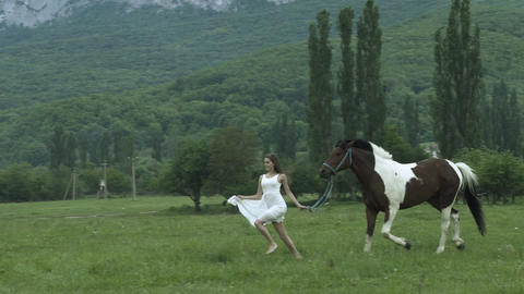 Young Beauty Running With A Horse Footage