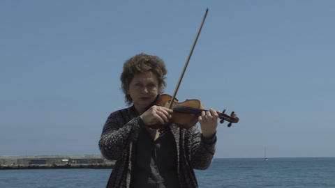 Street Violinist Plays At Seafront Footage