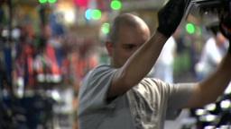 GENERAL MOTORS CAR FACTORY WORKER stock footage