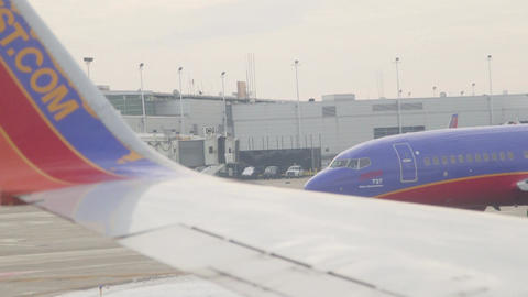 Chicago, Illinois, USA - November 2015: Southwest airplanes parked at Chicago Mi Footage