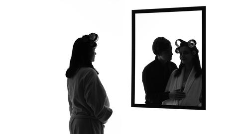 Pregnant depressed woman looking in mirror alone, imagining husband hugging her Footage