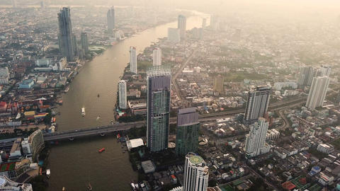Aerial view of Chao Phraya River, Bangkok Downtown. Financial district and Live Action