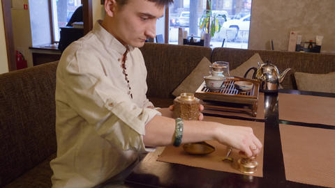 Tea master makes preparation for the tea ceremony Live Action
