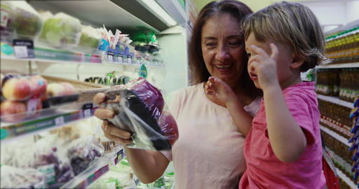 Adult woman with kid shopping together Footage