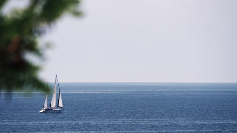 Sailing yacht in quiet blue sea Footage