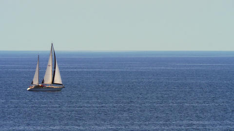 Yacht with sails in quiet blue sea Footage