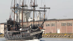 Galleon ship on a tour to Westerplatte. Shipyard in Gdansk in the background Live Action
