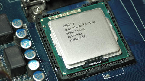 Man's Hand Puts Intel I5 Processor Into Motherboard Socket and Then Footage