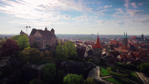 Aerial German Bavaria city with a castle in the foreground while zooming out in Footage