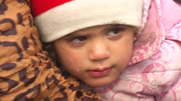 MIGRANT LITTLE GIRL WITH TEAR IN HER EYES FROM THE MORNING COLD Footage