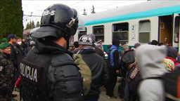 MIGRANTS GETTING OFF TRAIN AND WALKING PAST RIOT POLICE EU REFUGEES Footage