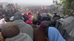 REFUGEES AND MIGRANTS TRICKLING ACROSS THE CROATIAN SERBIAN BORDER Footage
