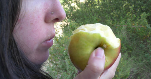 Woman bite from an apple yellow and chew it with pleasure 39 Footage