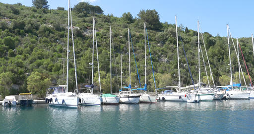 Boats moored on the shore of the island seen on board a boat cruise 58 Footage
