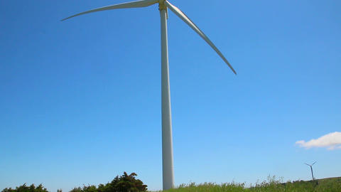 Wind generator in a field of grass Footage